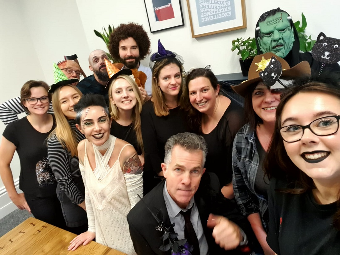 The 44 Communications team in Halloween costume