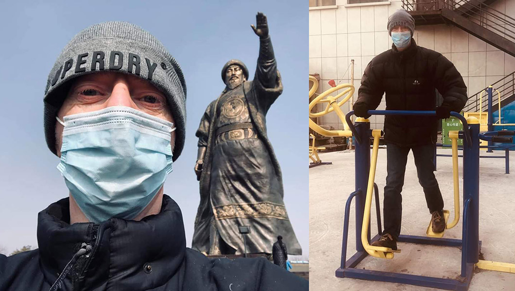 Simon Henning outside in China while wearing a face mask